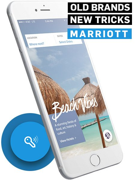 White smartphone showing a beach scene in the Marriott app
