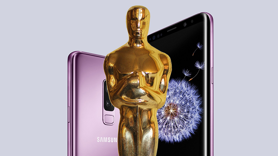 Oscar statuette in front of Samsung phone
