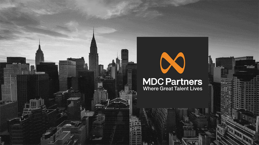 the new york skyline with the mdc partners logo in the foreground