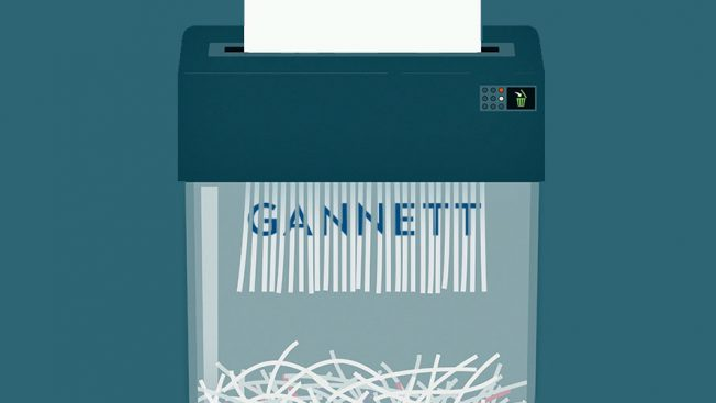A paper shredder shows a piece of paper with the word GANNETT being shredded