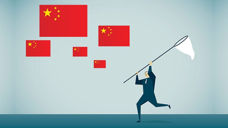 On the left there are five Chinese flags; on the right there is a man with a net and it appears that he is trying to catch the flags