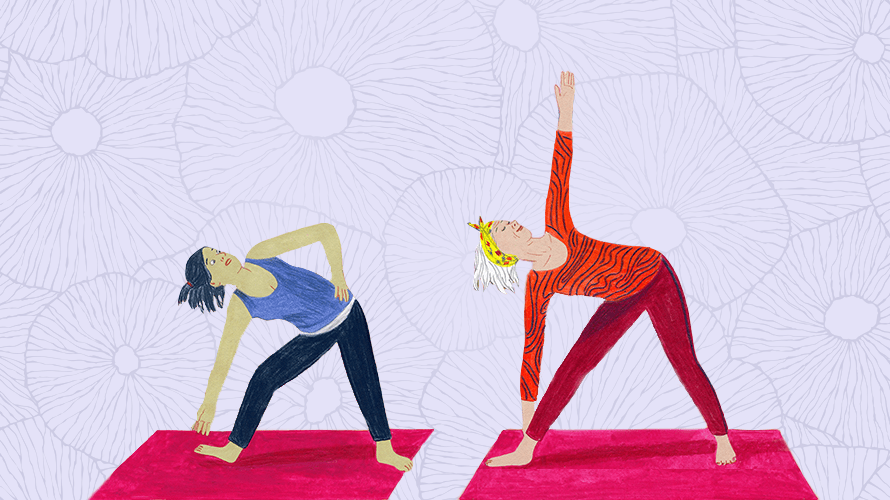 two women standing side by side striking a yoga pose