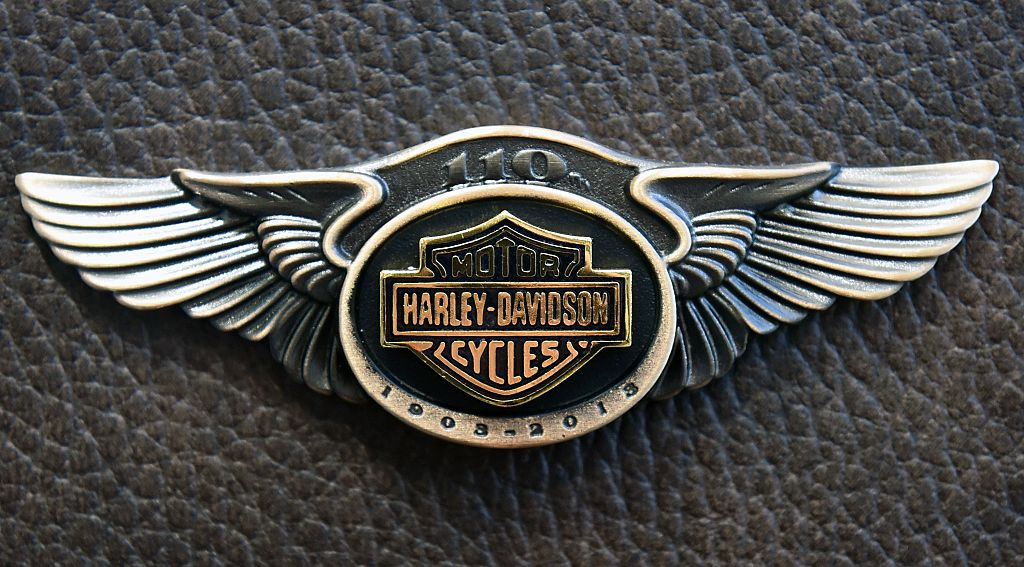 Harley-Davidson logo in metal on leather background