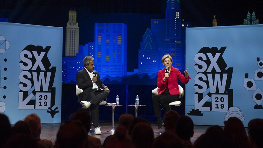 Elizabeth Warren talking on stage at a SXSW event