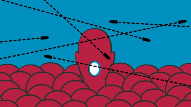 The background is blue; there are a copious amounts of tops of heads; one head is poking up; there is a light in the middle of the head; arrows wiz past the heads
