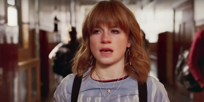 A red-headed girl from a Burger King AD is seen crying