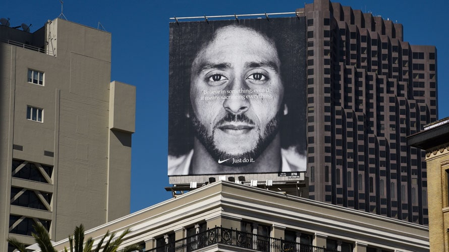 Nike's Colin Kaepernick ad is displayed on a billboard above a building.