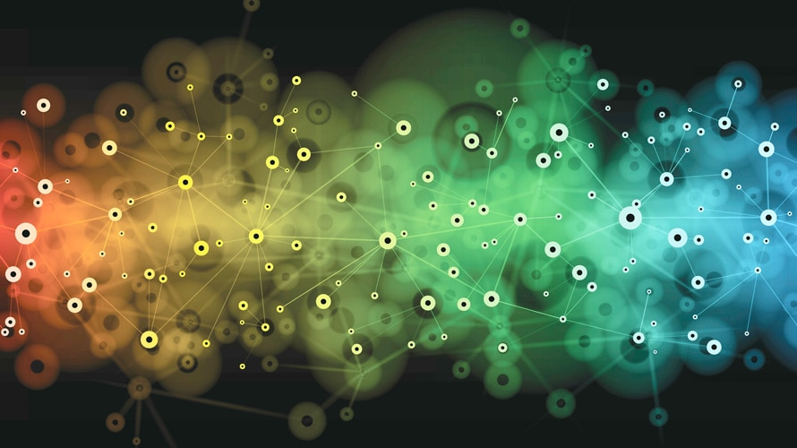 a bunch of dots that are inter-connected' the black background is lit up by red. yellow, green, and blue colors changing from left to right