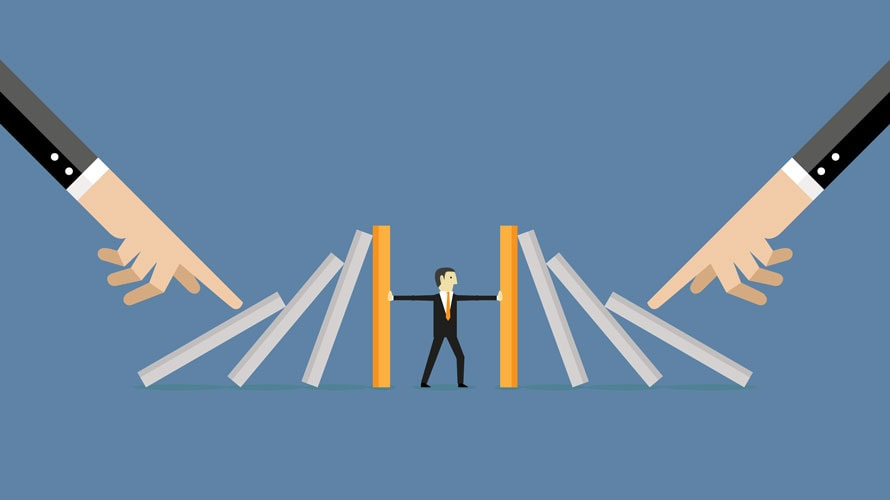 A small man trying to push up falling pillars; the pillars are being pushed down by two hands on each side of the background