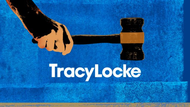 A hands holds a gavel on top of agency name TracyLocke.