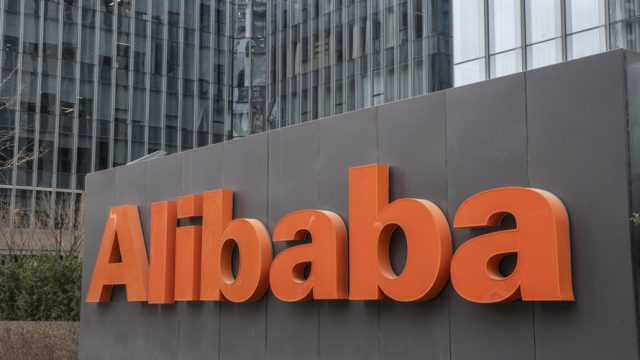 Alibaba sign in front of buildings