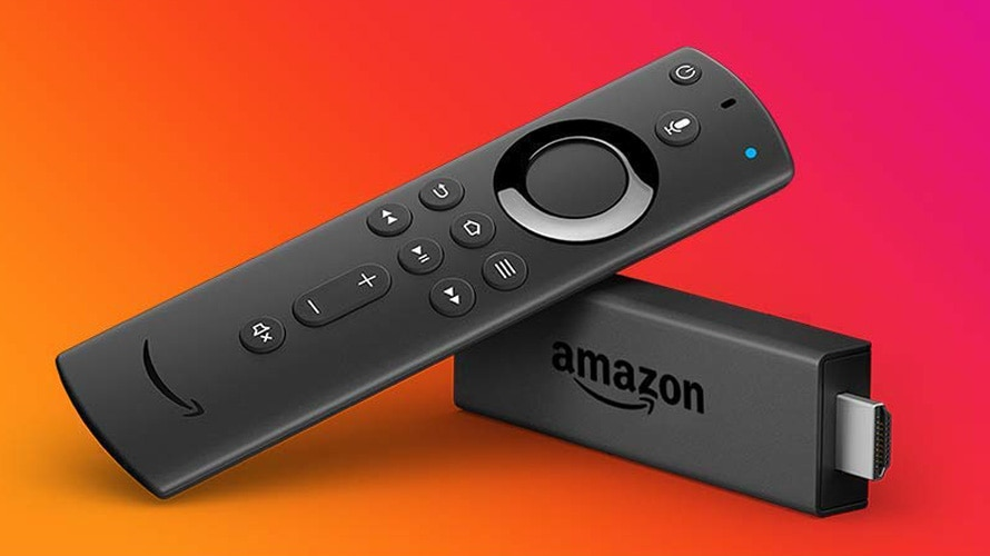 amazon fire tv dongle and television remote