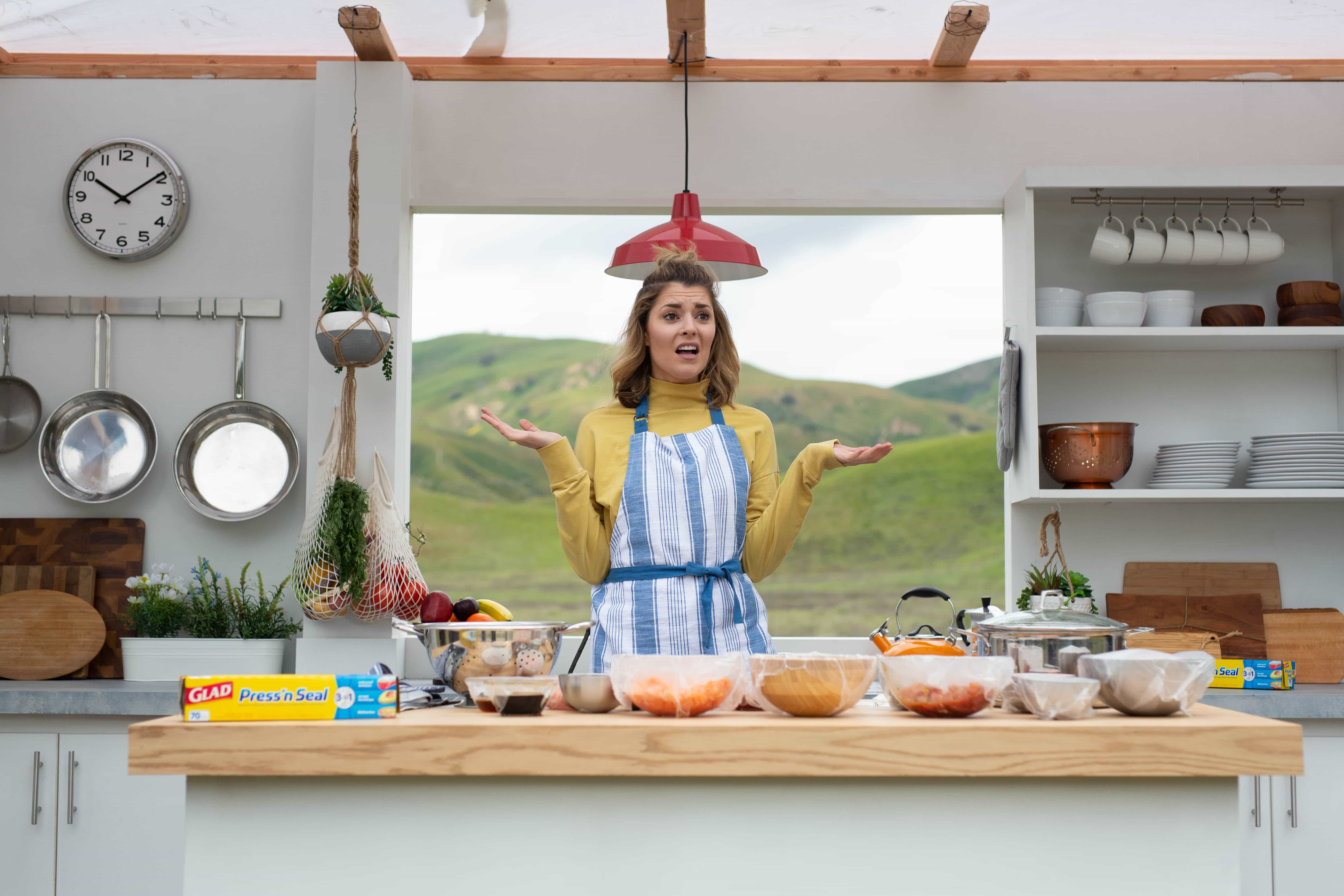 YouTube influencer Grace Helbig making a poke bowl in a moving kitchen for Glad Press