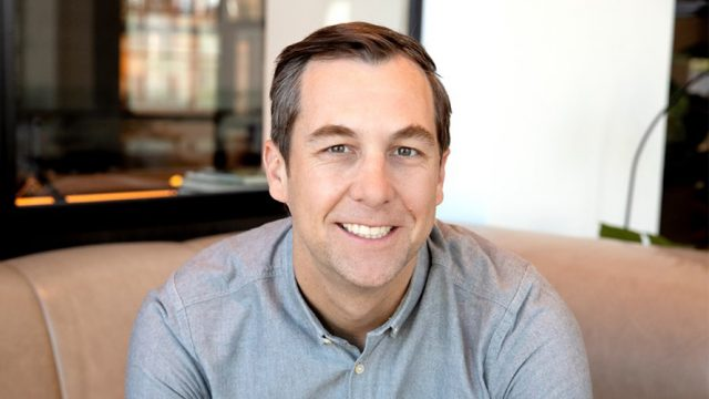 Photograph headshot of Ticketmaster president Jared Smith smiling