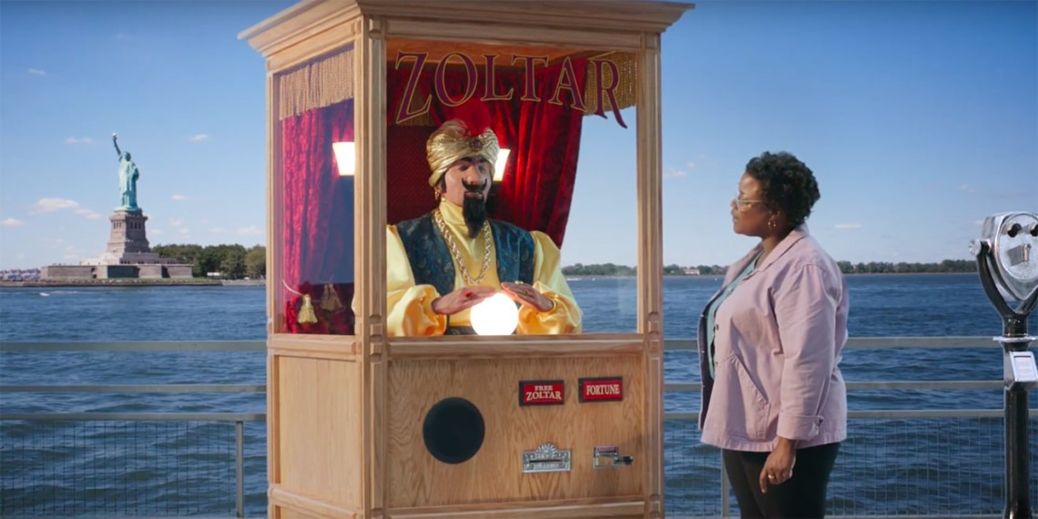 A woman visits a fortune-telling booth near the Statue of Liberty.