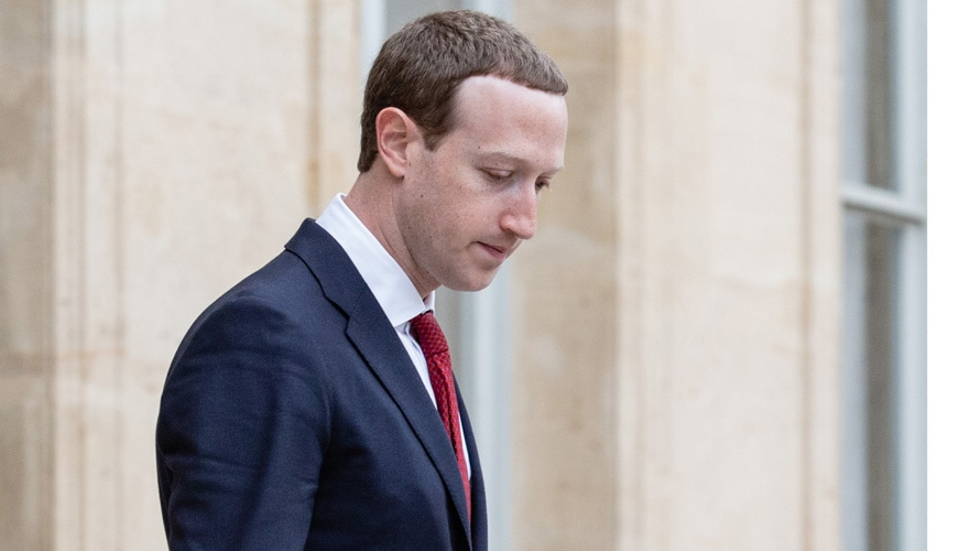Side profile of Facebook CEO Mark Zuckerberg looking down
