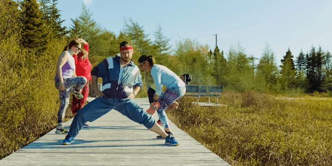 People work out in the Mount Pearl rap video.