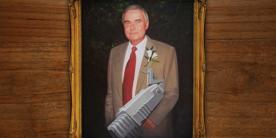 Portrait of Barton F. Graf holding the BFG 9000 gun from Doom