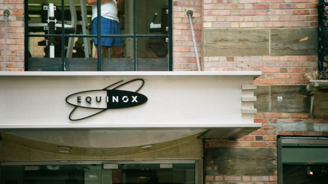 facade signage of an equinox fitness location with equinox logo