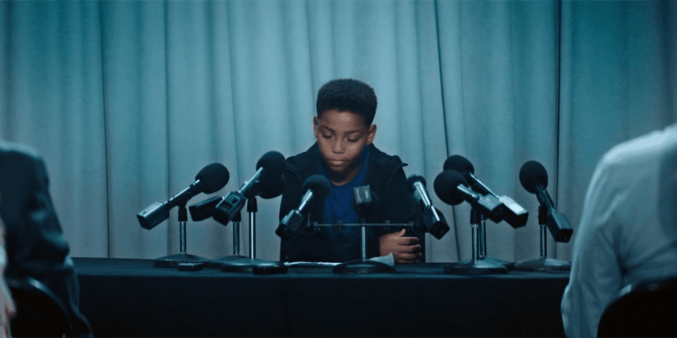 A child speaks into microphones in an ESPN PSA.