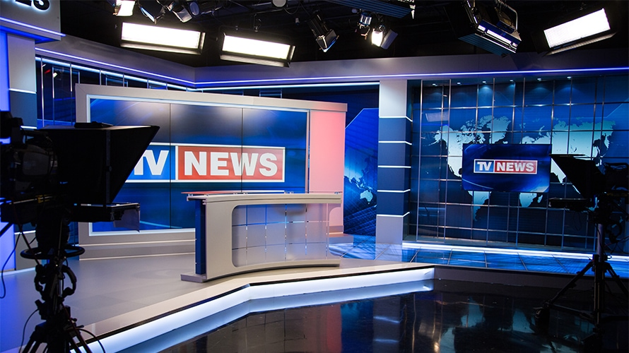 A TV news studio is shown.