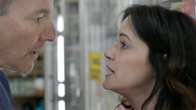 close up of man and woman having a heated discussion while in a store