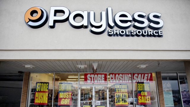 Payless store with signs for closing sales