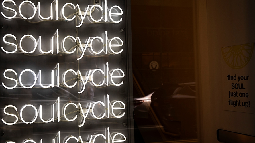 soulcycle logos in neon lights in a nyc studio storefront