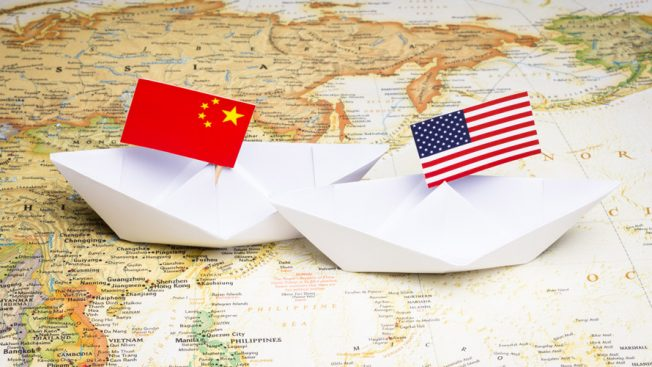A Chinese flag on the left and an American flag on the right.