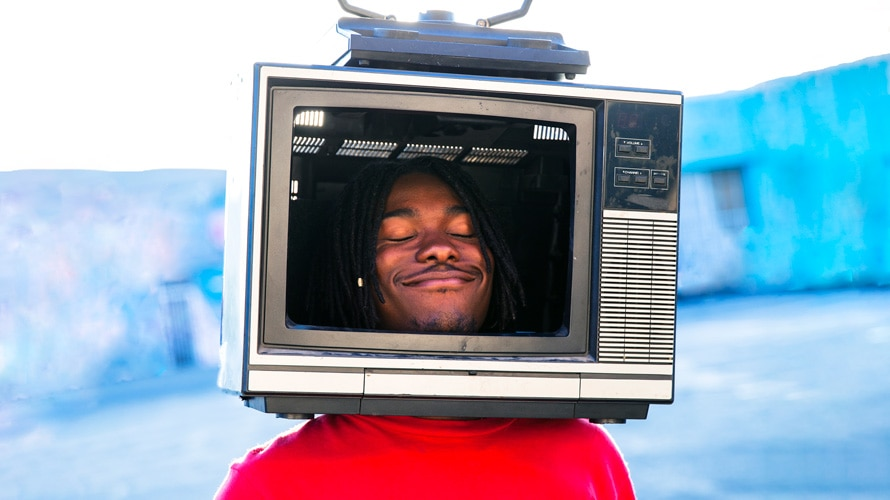 Young man smiling with TV helmet
