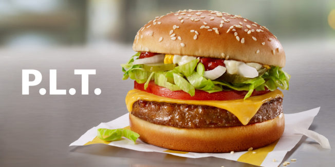 a mcdonald's burger with the letters P.L.T. next to it