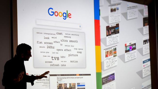 A silhouette in front of a Google search