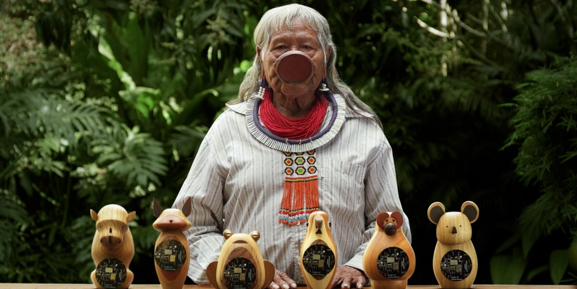 Indigenous leader and environmental activist Chief Raoni Metuktire presents the hardware mailed to construction tool makers