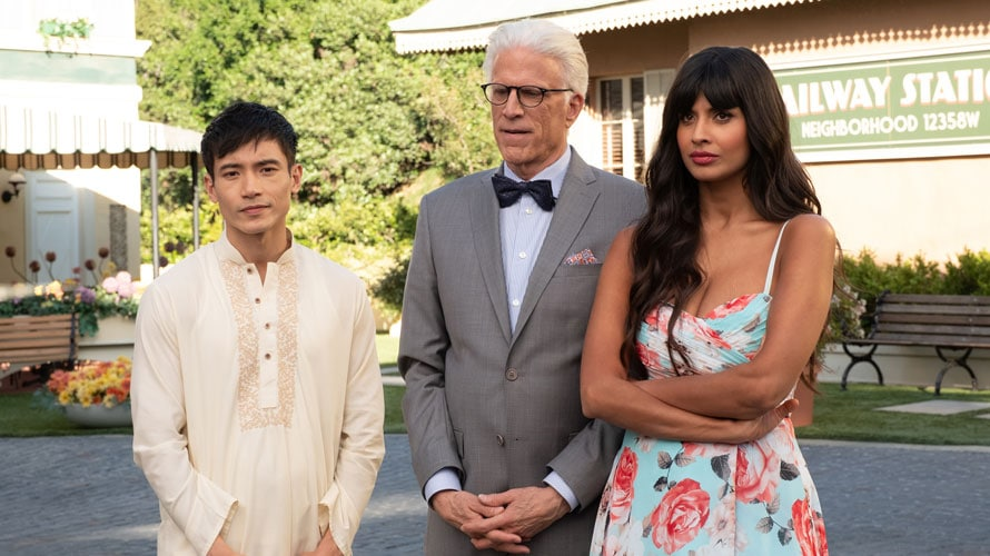 Actors Manny Jacinto, Ted Danson and Jameela Jamil standing next to each other on The Good Place