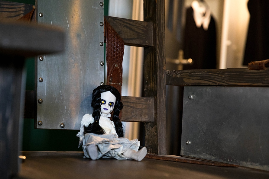 Scary ghost-looking doll sitting in an electric chair