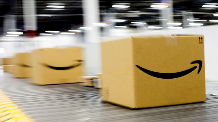 Amazon boxes on warehouse conveyor belt