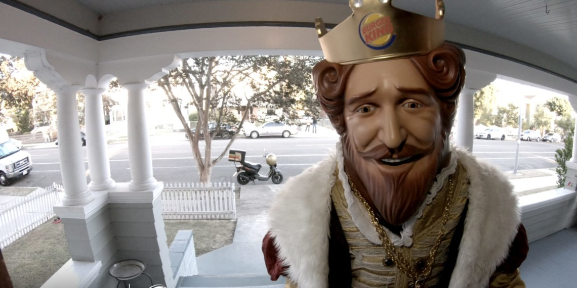 the burger king mascot standing on someone's porch