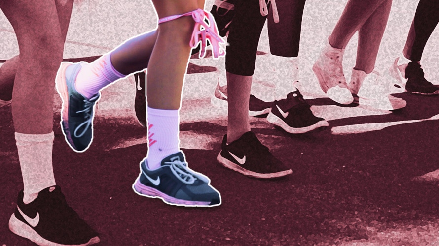people walking with pink socks and pink ribbons