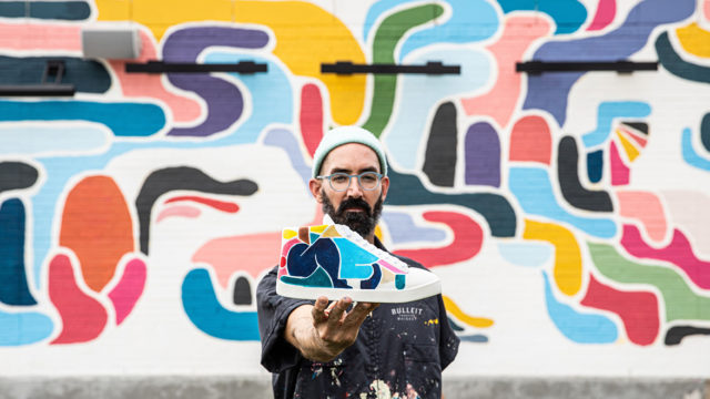 Street artist Kyle Steed posing with a 3D-printed shoe