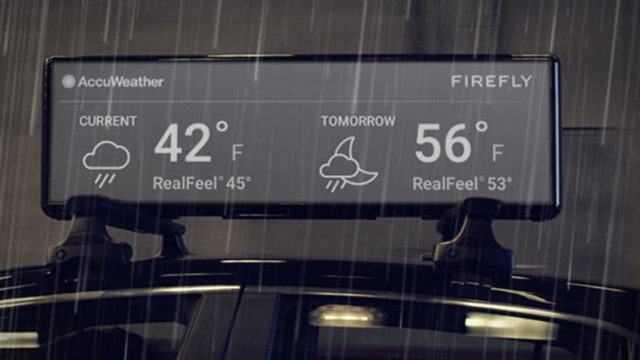 taxi-top ad by firefly showing the weather by AccuWeather