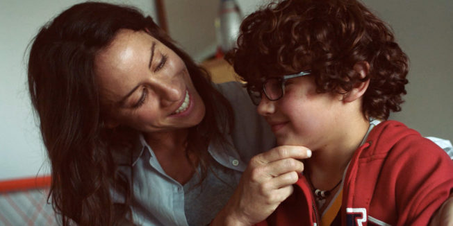 A mother comforts her son in Gap holiday ad.