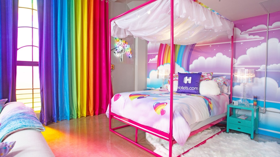 lisa frank hotel room with rainbows and clouds