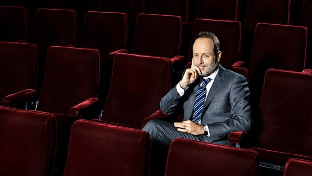 FX Networks chairman John Landgraf sits in red theater seats.