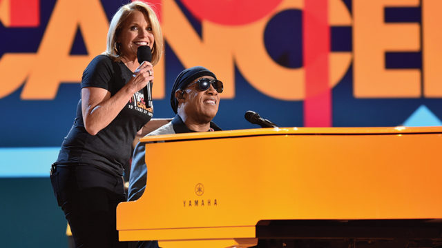 Katie Couric and Stevie Wonder onstage