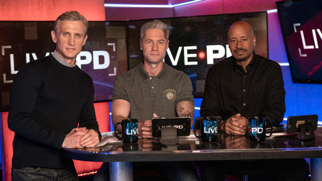 three men sitting at a desk with the Live PD logo in the background