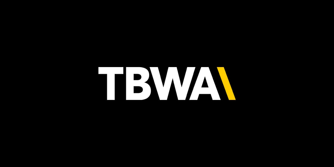 Black background with tbwa logo in white and yellow lettering.