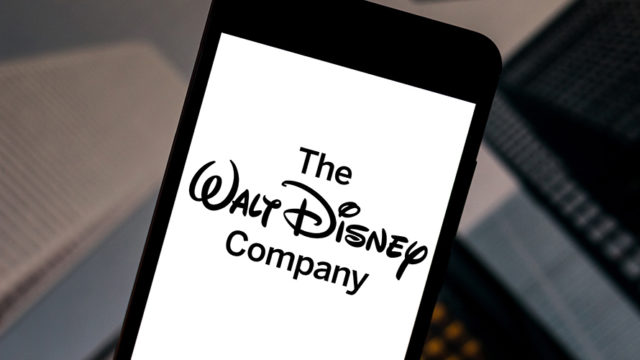 "A smartphone with a screen open that says ""The Walt Disney Company"""