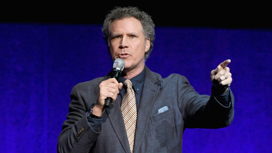 Will Ferrell speaking with a microphone in his hand