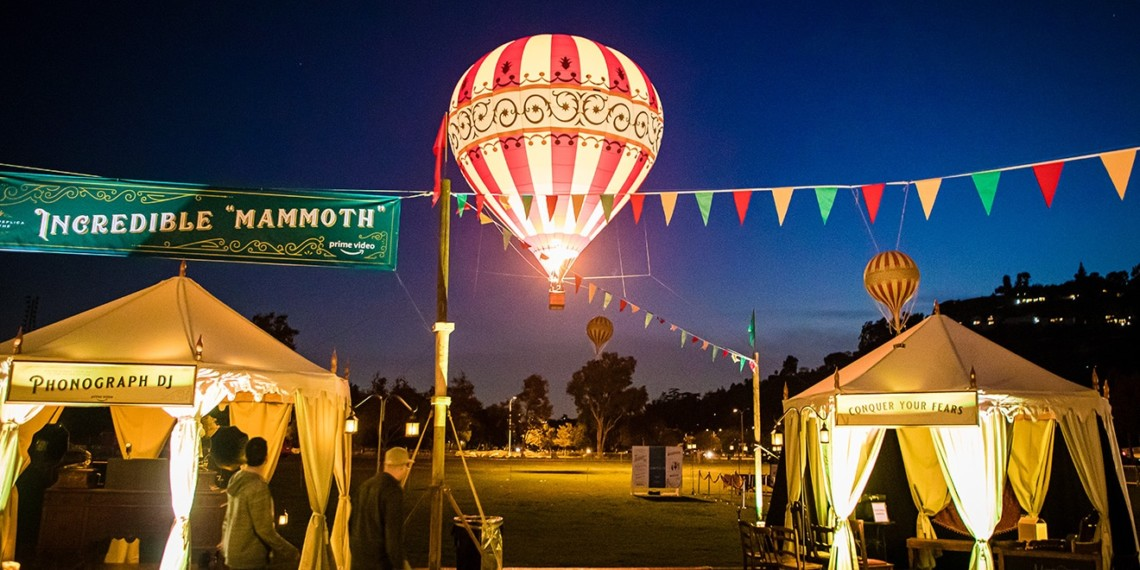 a hot air balloon surrounded by tents