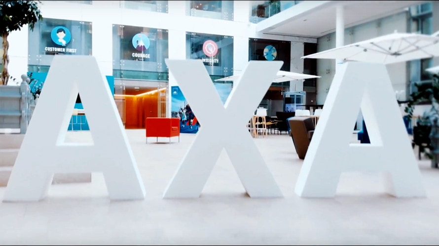 The letters AXA in an office